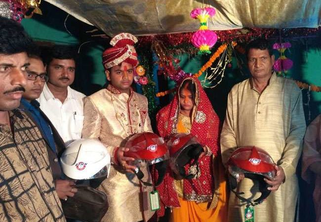 Indian bride gifts helmets to guests to create awareness about road safety
