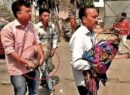 Denied stretcher, Indian villager carries sick baby in arms with oxygen cylinder