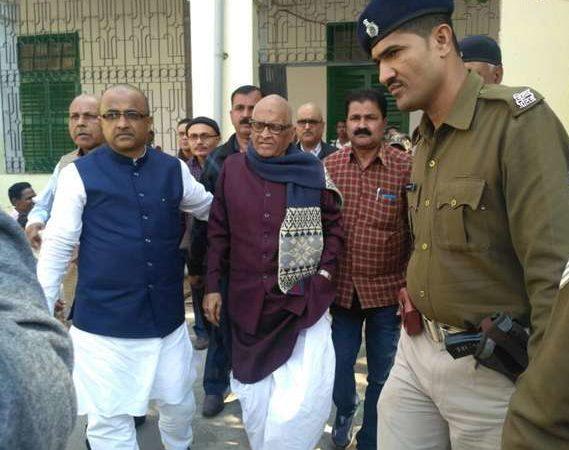 Former Bihar CM Mishra surrenders in fodder scam case, jailed