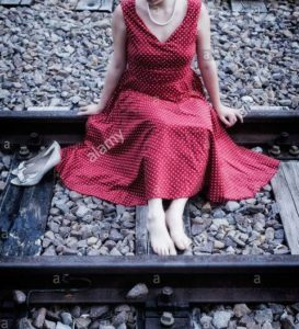 Woman in red clothes lies on tracks to end life but driver halts train thinking as 'danger sign'