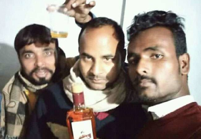 Selfie with alcohol bottle in 'dry' Bihar lands JD-U leader in trouble