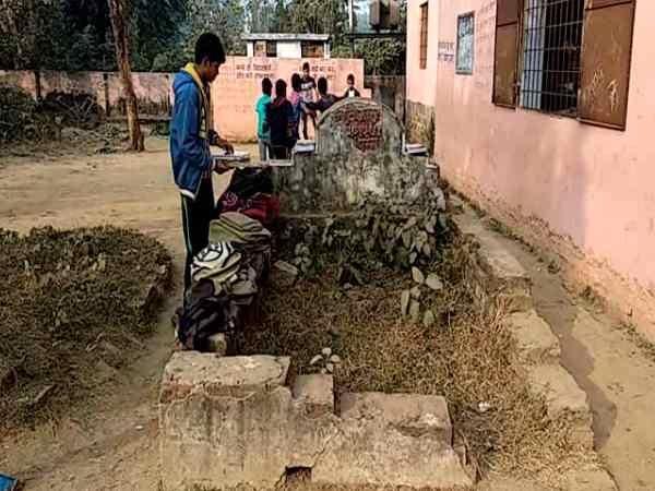 A school where children study among the dead enjoying eternal sleep in graves
