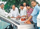 Indian judge holds court on road, disposes off files from car bonnet as court rooms remain flooded