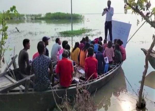 teaching on boat, school on boat, Katihar, Floods, Bihar floods, Bihar